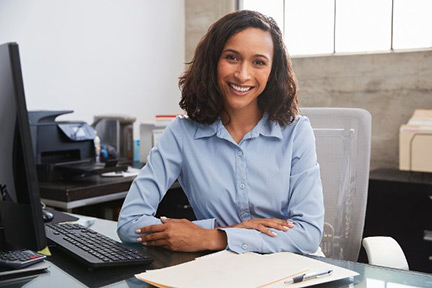 Woman sitting at computer desk