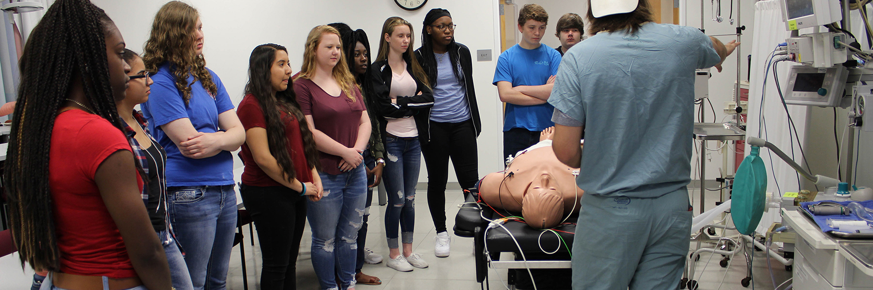 Group of students observing medical personnel