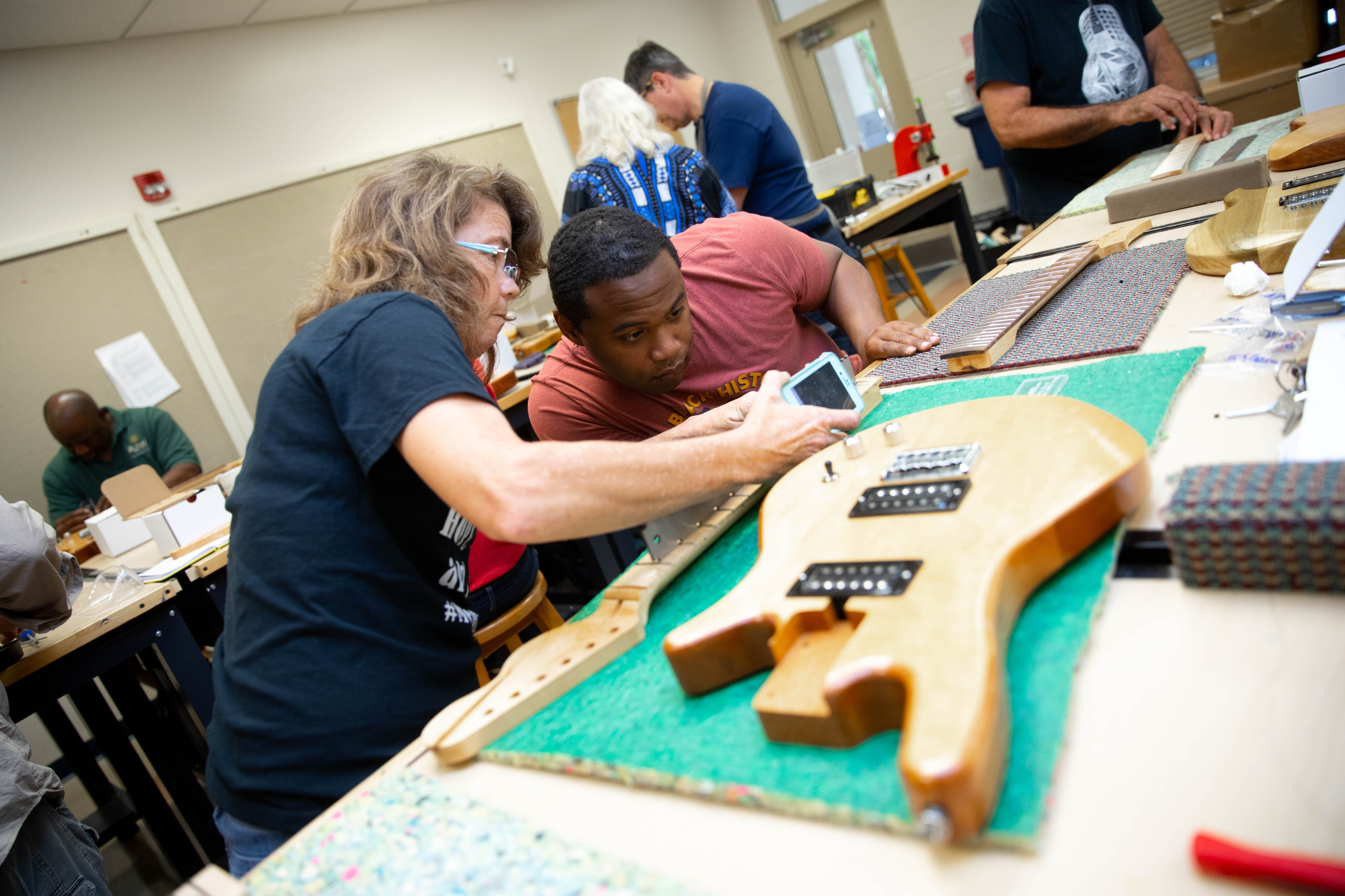 Picture of students building a guitar