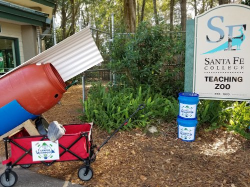 compost cart and 2 buckets in front of zoo entrance