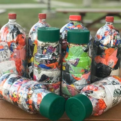 Plastic bottles stuffed with nonrecyclable plastic on table